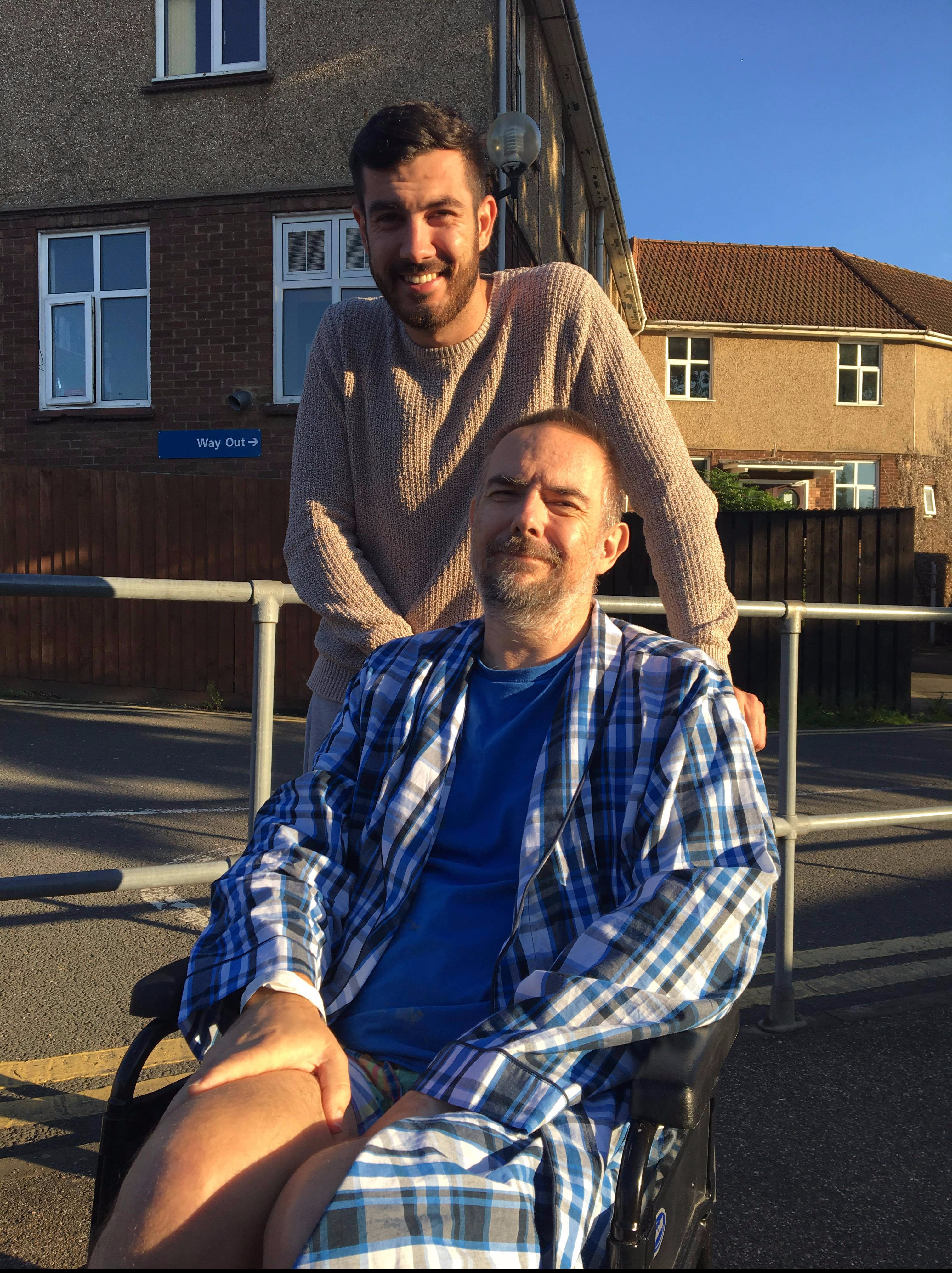 Dad and brother in the sun at Papworth Hospital